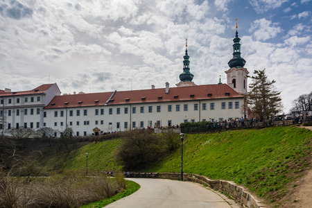Prague, Cechz Republic - April 4, 2018 : At its core, this abbey, situated in the middle of the Premonstratensian monastery at Strahov, is a Romanesque basilica with a Gothic transept and two Renaissance towers Stock Photo - 116199254