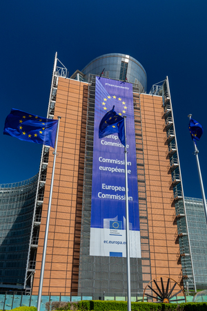 Brussels, Belgium - May 5, 2018 : European flags in front of headquarters of European commission in Brussels in summer day