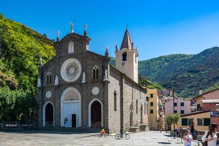 Riomaggiore, Italy - June 02, 2019 : Riomaggiore is a village situated in a small valley in the Liguria region of Italy. The water and mountainside have been declared national parks. Editorial