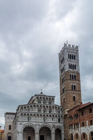 Lucca, Italy - June 6, 2019 : Lucca Cathedral (Duomo di Lucca, Cattedrale di San Martino) is a Roman Catholic cathedral dedicated to Saint Martin of Tours. It is the seat of the Archbishop of Lucca.