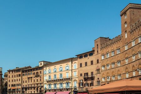 Siena, Italy - June 7, 2019 : Piazza del Campo is the principal public space of the historic and is regarded as one of Europe s greatest medieval squares.