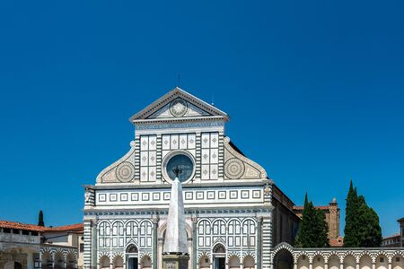 Florence, Italy - June 5, 2019 : Santa Maria Novella is a church in Florence, Italy, situated opposite, and lending its name to, the city's main railway station. Chronologically, it is the first great basilica in Florence.