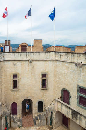 Saint-Tropez, France - June 11, 2019 : Tourists visiting the Citadel in St Tropez, an amazing piece of architecture and offers great views of the town and bay beyond.