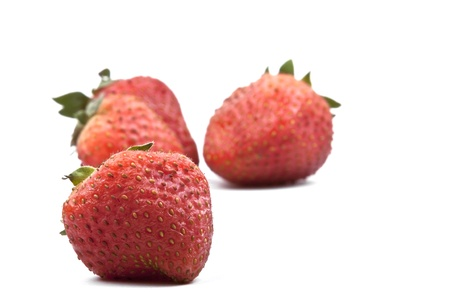 Red strawberries on a white background photo