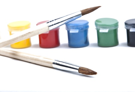 Paintbrush and paint on a white background photo