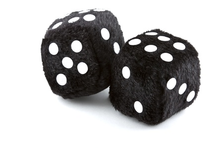Black furry dice on a white background photo
