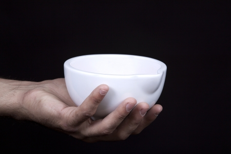 starvation: A hand holding a bowl  Stock Photo