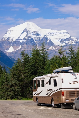 motor home: Recreational vehicle before mountains