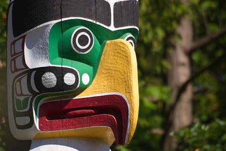 Close up of fierce eagle totem pole  photo