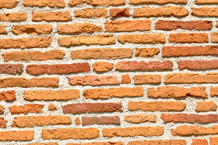 Bright picture of an orange brick wall