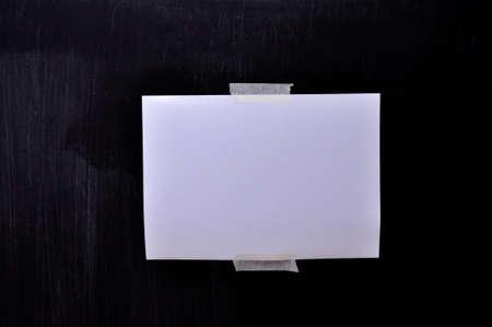 white paper in middle of blackboard Stock Photo