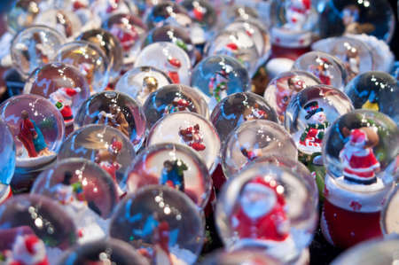 Display of winter snow globes with different characters