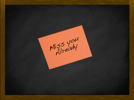 Miss you note on a framed blackboard