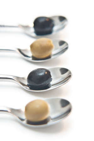 Black and Green Olives on teaspoons Stock Photo - 8717902