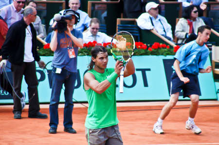 nadal: PARIS, FRANCE - MAY 2008: Rafael Nadal from Spain during his first round match against Thomaz Bellucci at Roland Garros on May 28, 2008 in Paris. Rafael NADAL (Spa) beat Thomaz Bellucci (Bra) 7-5 6-3 6-1 and went on to win the tournament.