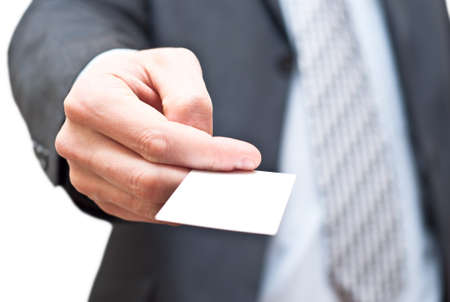 Man in dark suit giving an empty business card