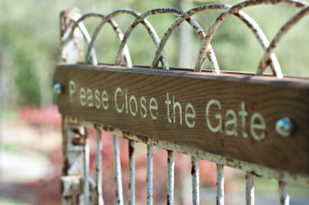 open gate: Please open the gate sign on an iron gate with wood Stock Photo