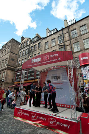 EDINBURGH, SCOTLAND - AUGUST 13, 2011 - An a capella vocal band performs on a Royal Mile mini-stage during the Fringe Festival.