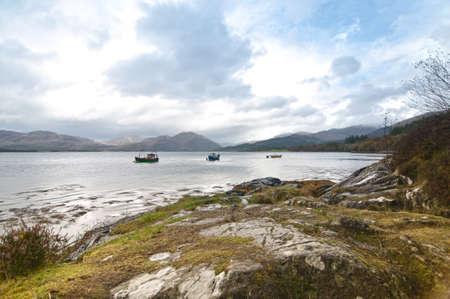 loch: Three fishing boats on a Scottish Loch