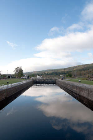 Fort Augustus Locks with reflection of the sky Stock Photo