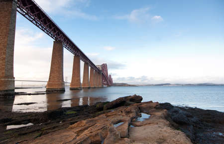 Forth Rail Bridge landcape with foreground rocks photo