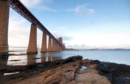 Forth Rail Bridge landcape with foreground rocks photo