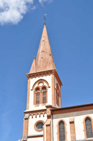 Renovated church tower in St Lys, France Stock Photo - 12659235