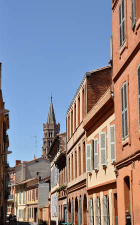 Toulouse in the south of France with typical architecture made of red bricks against bright blue sky - St Sernin basilica