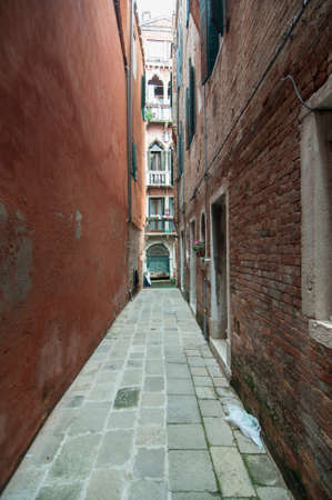 Small colourful venetian street in a popular neighbourhood Stock Photo