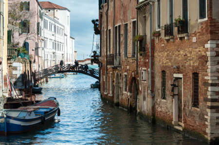 Typical picturesque Venice with brick buildings along one of the many canals Stock Photo