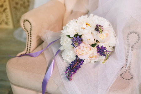 Luxurious wedding bouquet of purple, pink and white flowers. Wedding composition from multi-colored pions in a soft chair. Stok Fotoğraf