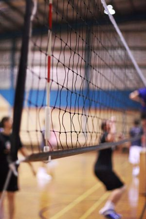 indoors: Volleyball net on an indoor court