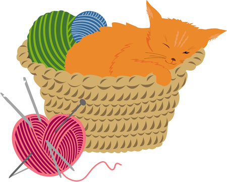 Sleeping kitten in a basket with knitting balls