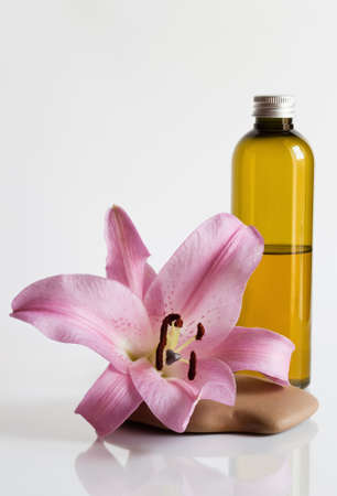 naturopathy:  Massage oil and lily Stock Photo