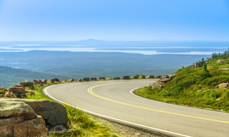 Cadillac Mountain drive in Acadia National Park, Maine in a clear summer day  A ponoramic view of distant lakes and hills  photo
