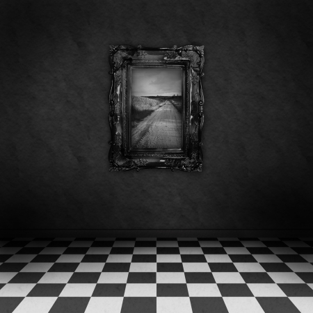 Empty, dark, psychedelic room with black and white checker on the floor and a painting symbolizing hope, on the dark wall  photo