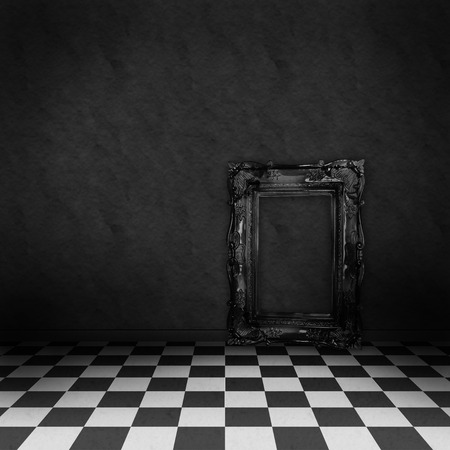 art museum: Empty, dark, psychedelic room with black and white checker on the floor and empty black frame. Nightmare or dream, museum scene or art gallery. Stock Photo
