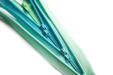 Open zipper pastel set isolated on white background photo