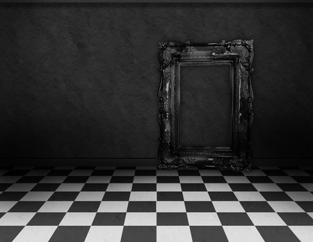 Empty, dark, psychedelic room with black and white checker on the floor and empty black frame. Nightmare or dream, museum scene or art gallery. photo