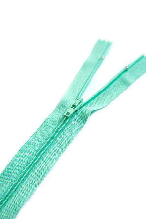 Green zipper isolated on white background photo