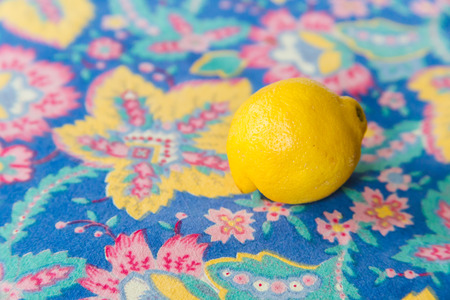 tablecloth: Yellow lemon fruit on colorful floral tablecloth