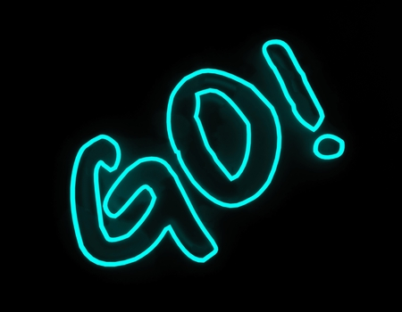 neon sign: Go neon sign isolated on black background