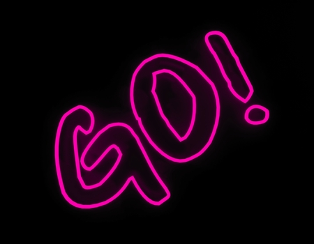 Go neon siegn isolated on black background Stock Photo
