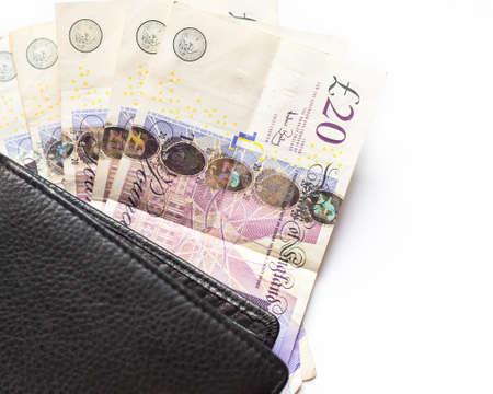 british money: UK money. British 20 pounds bills and wallet on white background