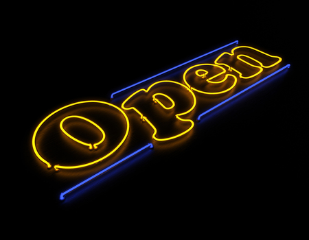 Open neon sign isolated on black background Stock Photo