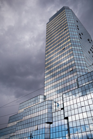 Blue Tower skyscraper in Warsaw, Poland on cloudy day Editorial