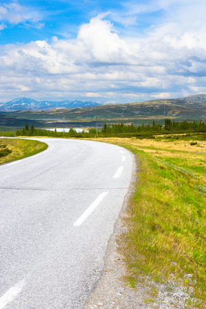 Road in Norway. Summer landscape with blue sky and mountains