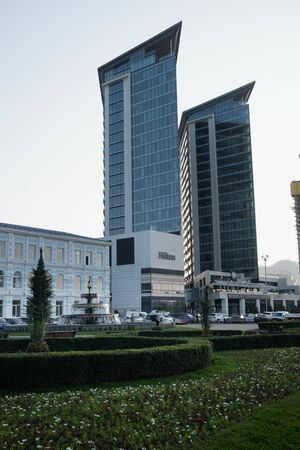 BATUMI, GEORGIA - November 19 2019 : Hilton Hotel two towers with entrance to the building, hotel name, fountain. 5 stars.