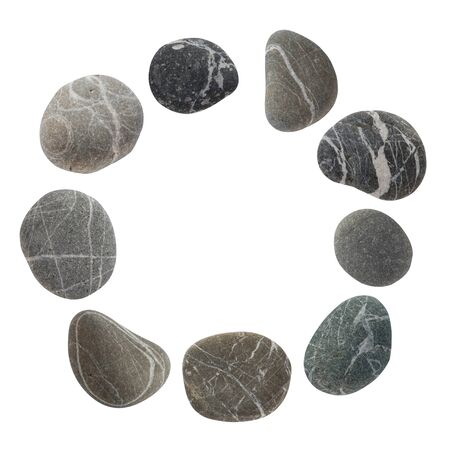 Round frame from a set of different color stones. Stock photo element Scandinavian trend design isolated on white background.