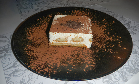 Tasty dessert tiramisu on plate with hearts Фото со стока